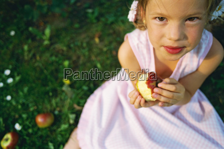 portrait of young girl eating an