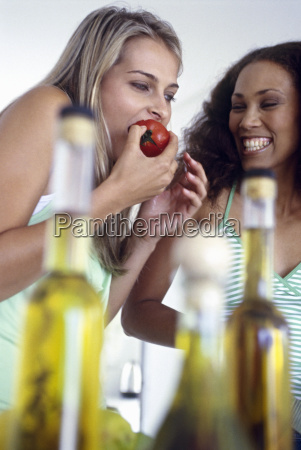 view of two woman eating fruit
