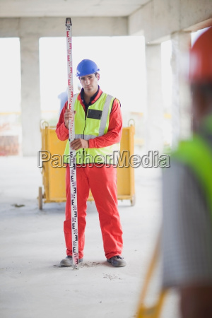 building worker doing some measuring