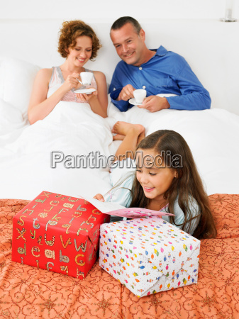 girl on bed looking at birthday