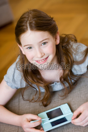 girl playing video games looking up