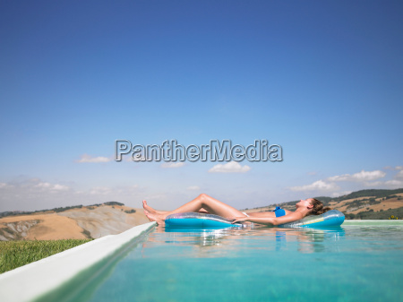 woman resting in swimming pool