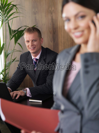 business man and woman in office