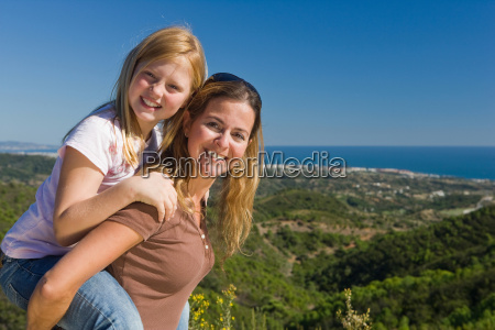 mother and daughter piggyback ride