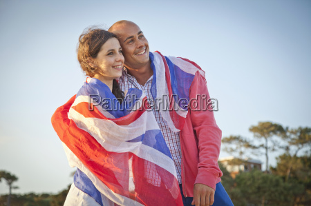 couple wrapped in british flag on