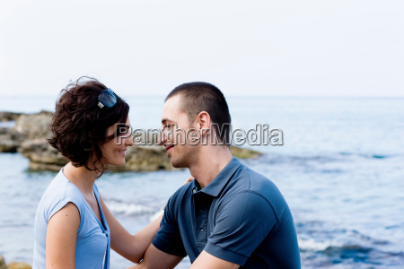 couple sitting together on waterfront
