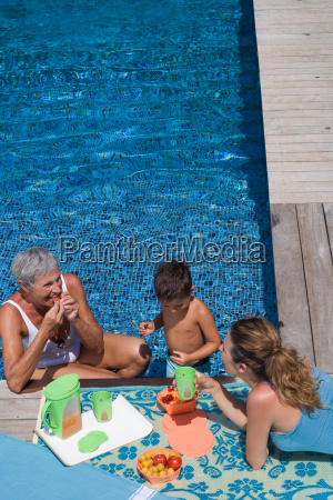 woman and boy in swimming pool
