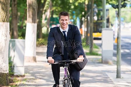 meski jezdziectwo biznesmen samiec rowerzysci rower