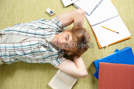 young man lying on rug