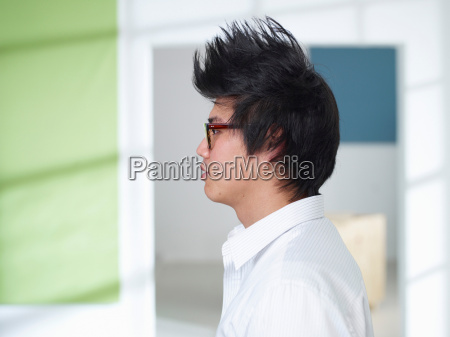 young man with mohawk and glasses