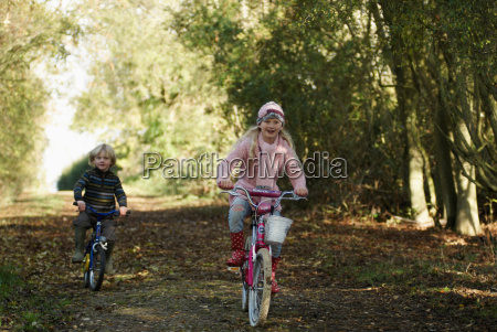 boy, and, girl, riding, bikes, in - 18272658