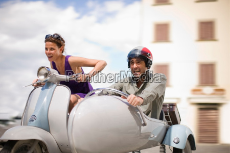 couple, driving, a, scooter - 18277028