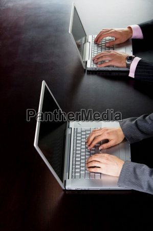 business man and woman on computers