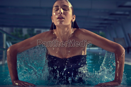 woman rising from swimming pool