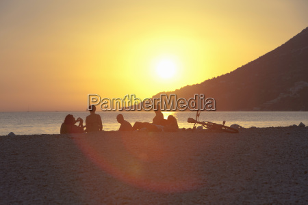 small group of people watching sunset