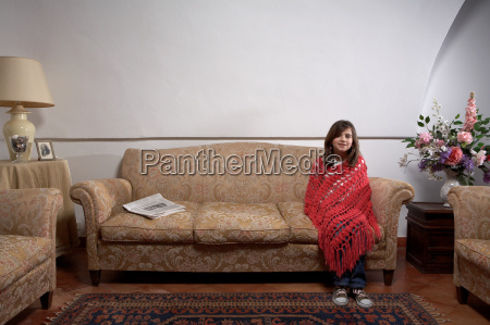 girl sitting on a sofa