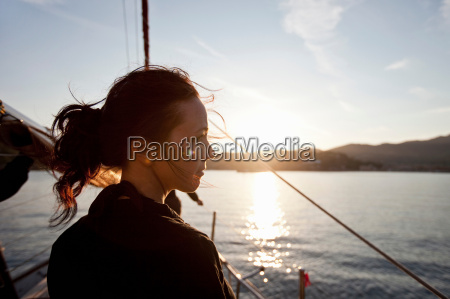 woman on a boat watching the