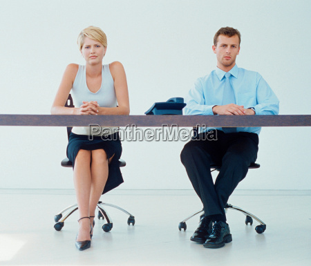 business people sitting at desk