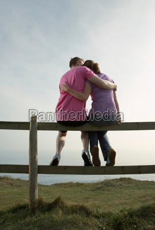 a couple hug sitting on a