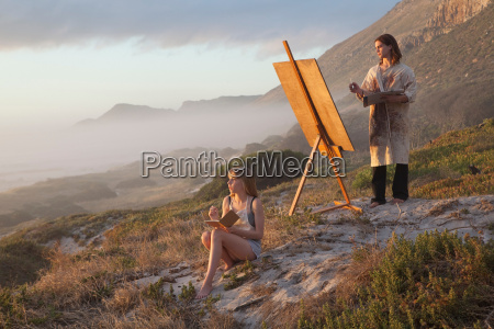 young man and woman painting