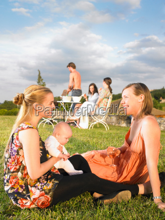 group of young people at barbecue