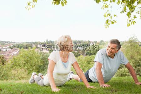 mature couple doing push ups in