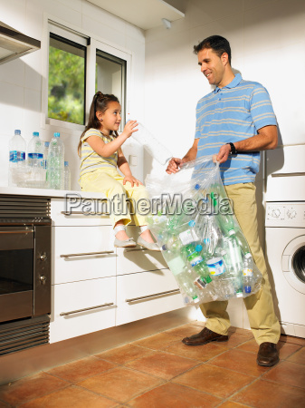 father and daughter sharing recycling