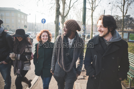 five young adult friends strolling in