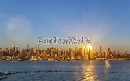 sunlit skyline of midtown manhattan new