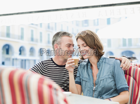couple sitting in a city cafe