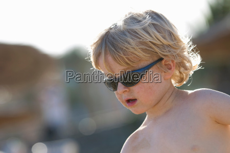 boy wearing sunglasses outdoors
