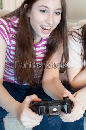 teenage girl playing a video game