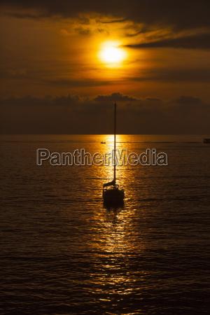 silhouetted yacht at sunset camogli liguria