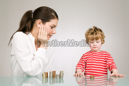 woman and boy with coins