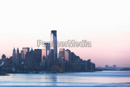 manhattan skyline and waterfront at dusk