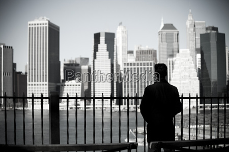 man looking to lower manhattan from