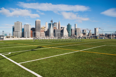 soccer fields and lower manhattan skyline
