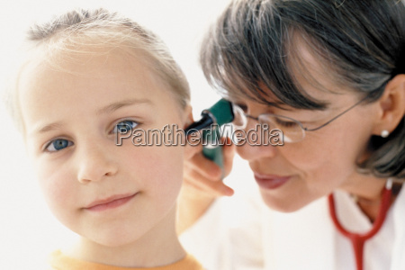 girl being examined by doctor