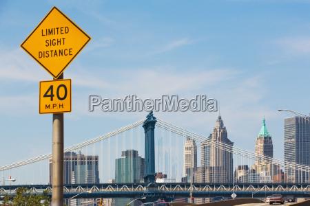 road sign and manhattan skyline