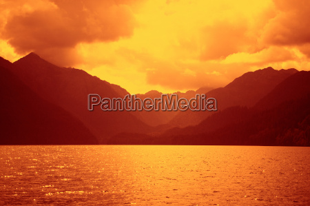 mountains and water glowing in sunset