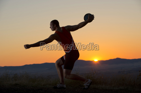 young man preparing to throw discus