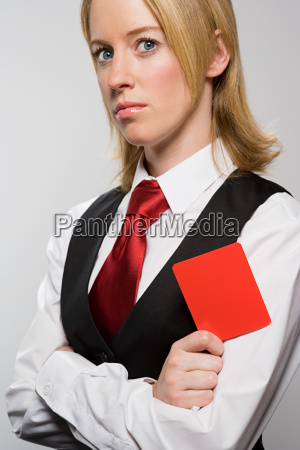 businesswoman holding red card