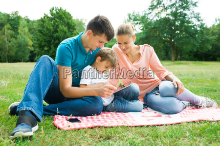 family using digital tablet in the