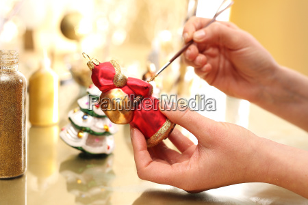 decorating christmas balls brush woman paints