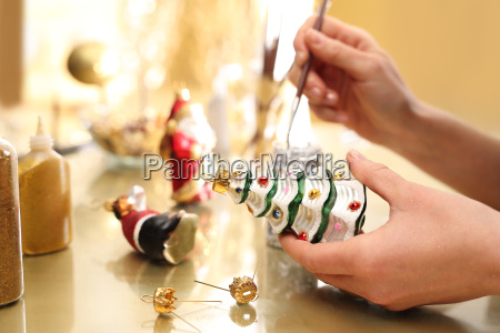 decorating christmas baubles the woman paints