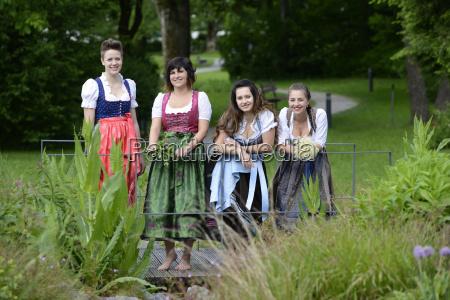 germany bavaria four smiling women wearing