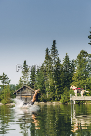 man dives into the water while