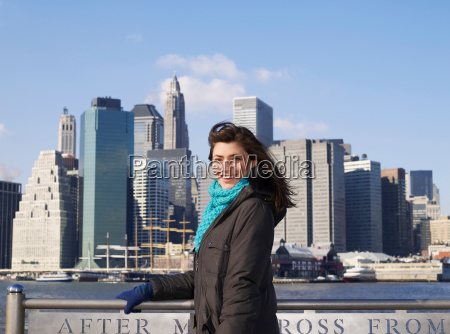 woman with view of manhattan behind