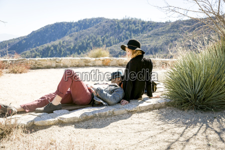 young couple relaxing on viewing platform