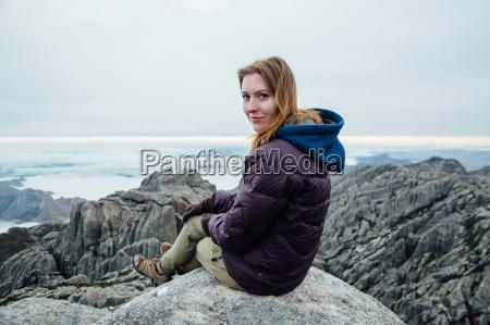 portrait of mid adult woman sitting